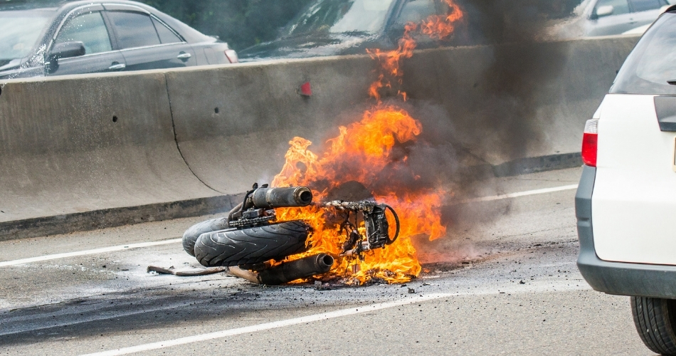Motorcycle on fire after accident